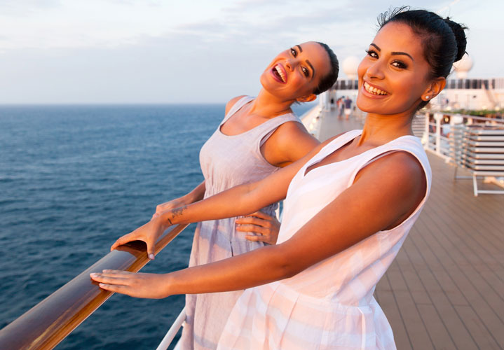 Two women smiling on a boat