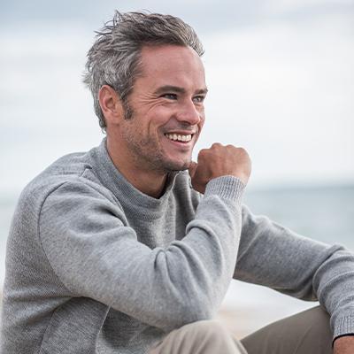 Man smiling on beach