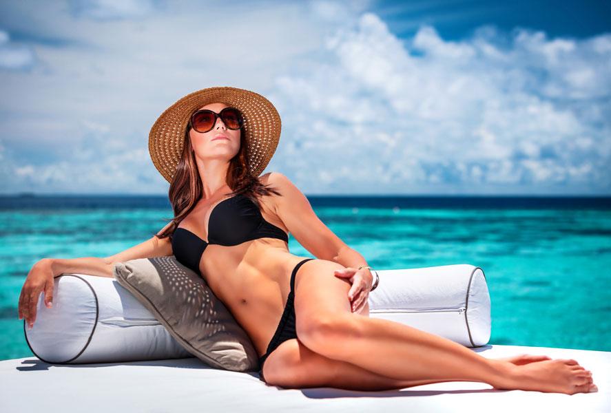 Woman sunning on beach