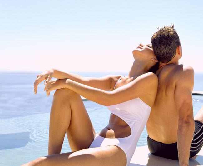 Couple enjoying sun on the water