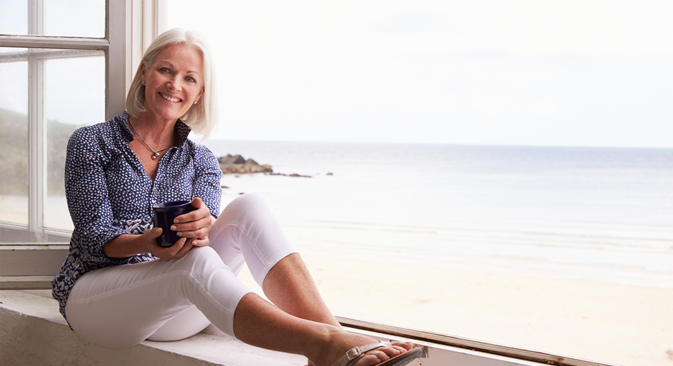 Older woman sitting in front of window